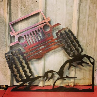 Metal wall art depicting a Jeep climbing rock with a Multi-Color Patina finish on the metal.