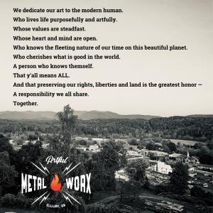 Artful MetalWorx Manifesto on black type over the mountain skyline of Ellijay, GA, the home of Artful Metal Worx