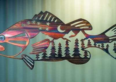Metal wall art of bass with mountain scene in body. This metal art has a Multi-Color Patina finish.
