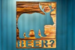 Beer Bear Deer Metal Art is a square piece of metal with a bear with deer antlers and the phrase Beer? in below the image.