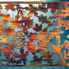 Metal wall art depicting fall leaves on metal cut square.