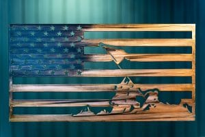 Metal wall art of an American Flag made of metal depicting the image of Raising the Flag at Iwo Jima finished with a Camo Patina
