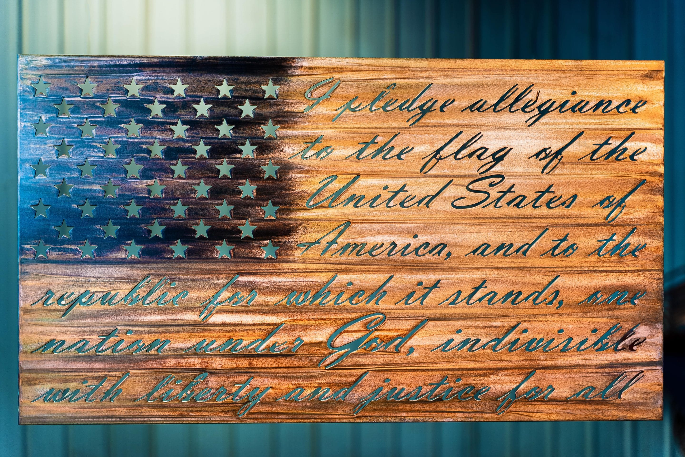 American Flag with the pledge of allegiance and stars cutout of it.