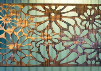 Metal Art Wall Decor rectangular Screen with Daisy pattern and a wood grain copper patina