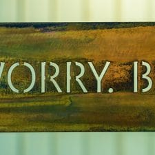 Don't Worry Be Happy on woodgrain copper metal art