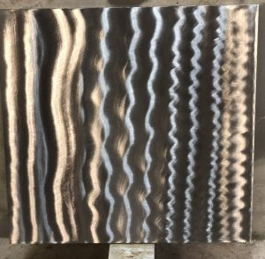 Sample photo of a clear coat finish from Artful MetalWorx metal art. The metal has a bright silver look that accents the polished steel showing the grinder marks where the metal was hand finished.