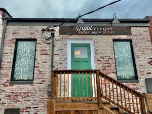 Photo shows the back of Artful Ellijay a retail home decor store in Downtown Ellijay. This picture show Artful MetalWorx metal art for the Artful Ellijay Home Provisions letters as well as the custom screens in the windows.