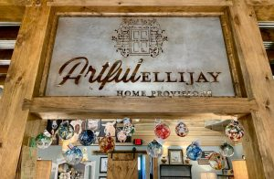Photo of Artful Ellijay Home Provisions in-store sign cut out of metal. This photo was taken at Artful Ellijay a retail store in Downtown Ellijay, GA.