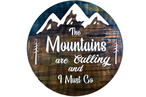 The Mountains are calling and I must go metal wall art is a circular piece of metal with the phrase cut into the metal with mountains in the background. This photo shows the metal art without the background.