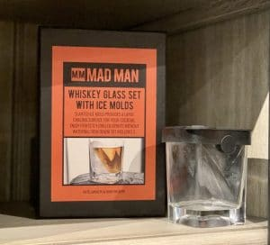 Photo of Artful Ellijay Home Provisions display with Father's Day gifts and gifts for him. Gift shown is Whiskey Glass Set with Ice Molds. This photo was taken at Artful Ellijay a retail store in Downtown Ellijay, GA.